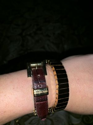 Michael Kors brown leather bracelet with gold accents for Sale in Brandon, FL