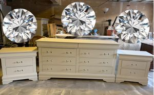 A beautiful white set 1 lowboy dresser with 8 drawers and 2 matching night stands with 3 drawers for Sale in Brentwood, CA