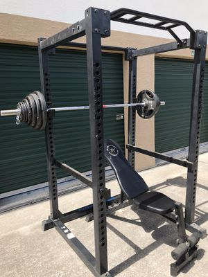 SQUAT / POWER RACK ADJUSTABLE WEIGHT BENCH AND OLYMPIC WEIGHT SET for Sale in Wesley Chapel, FL