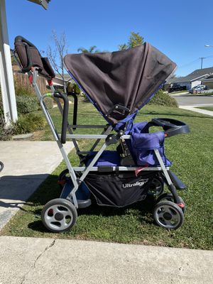 Joovy caboose ultralight double stroller for Sale in Anaheim, CA