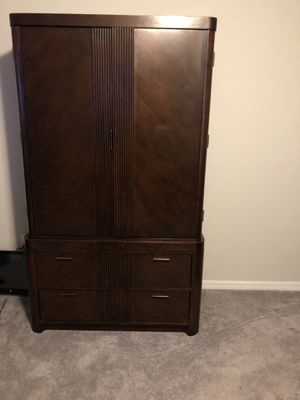 Armoire and dresser with mirror dark walnut in color for Sale in Gibsonton, FL