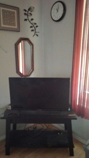 Tv stand tv is on mirror on the wall and small pic above mirror all for sale for Sale in Tulsa, OK