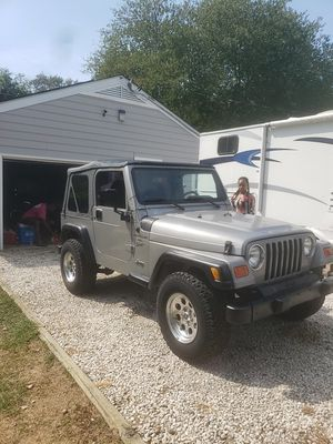 2000 jeep wrangler sport 165k runs good trans is starting to slip auto magic little rust new top and extras 4000.00 obo for Sale in Upper Marlboro, MD