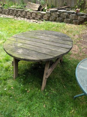 Wooden table with four wooden stools for Sale in Sterling, VA
