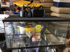 60 gallon reptile tank ! I used it for a bearded dragon ! Comes with black heat lamp for night , daytime basking light and daytime heat and power sun for Sale in Walpole, MA