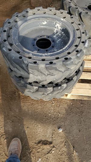 Skid steer solid tires for bobcat (4 tires) for Sale in Los Angeles, CA