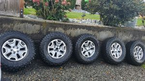 Factory jeep jk wheels with 35in tires for Sale in Puyallup, WA