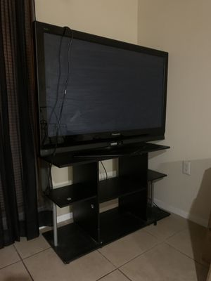 Black 55' TV with stand 📺! for Sale in Tampa, FL