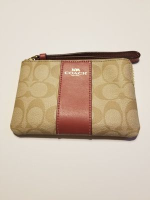 NEW WITH TAGS COACH WRISTLET! TAN AND PINK WITH GOLD HARDWARE! for Sale in Garland, TX