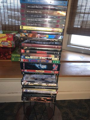 DVD's for sale. 78 normal DVD's. 41 kid's DVD's featuring Disney movies. Stands included for Sale in Collinsville, IL