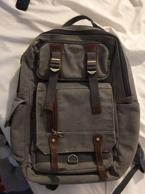 Used backpack laptop sleeve couple missing buttons but still in Great shape carry wise for Sale in Smyrna, GA