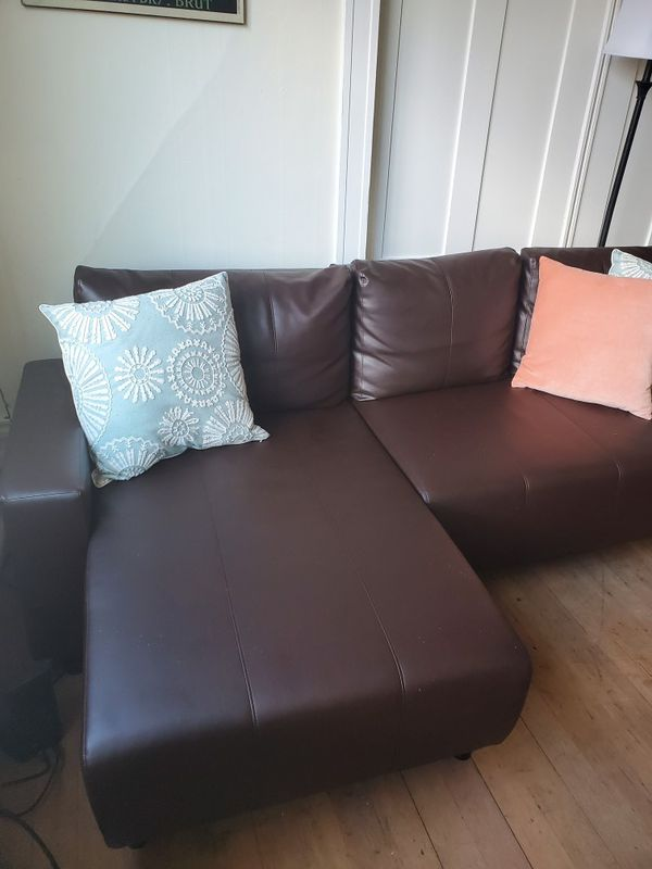 L- shaped brown faux-leather futon counch with storage