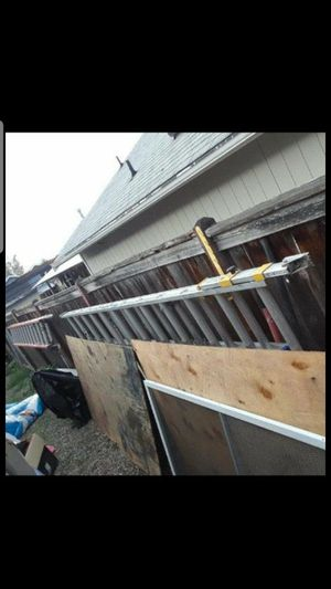 28 and 24 ft aluminum ext. Laddersm for Sale in Seattle, WA