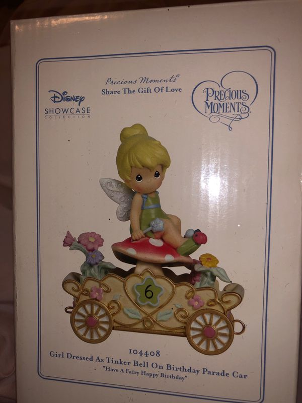 Precious moments Disney showcase girl dressed as tinker bell on birthday parade car