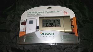 Self setting Atomic projection clock- new for Sale in Seattle, WA