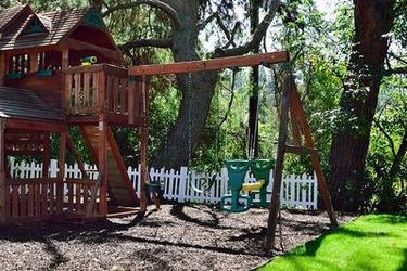 GRAND PLAY SWING SET - WITH TREE HOUSE AND SLIDE for Sale in Sierra Madre,  CA