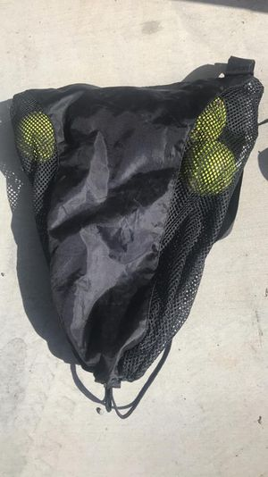 7 softballs and 2 gloves 1 used and 1 lol brand new for Sale in San Diego, CA
