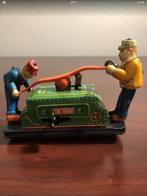 Tom & Dick Railroad Hand Car Vintage Wind Up Tin Toy Turn the key wind With a turn key wind and when it rolls along, the men on either side of the for Sale in San Diego, CA