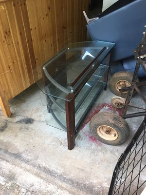 Glass and cherry wood TV stand for Sale in Douglasville, GA