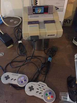 Super Nintendo with 2 controllers and 5 games for Sale in Everett, WA
