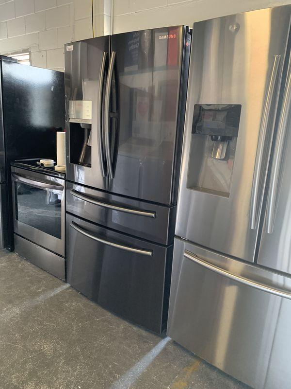 Black stainless four door refrigerator