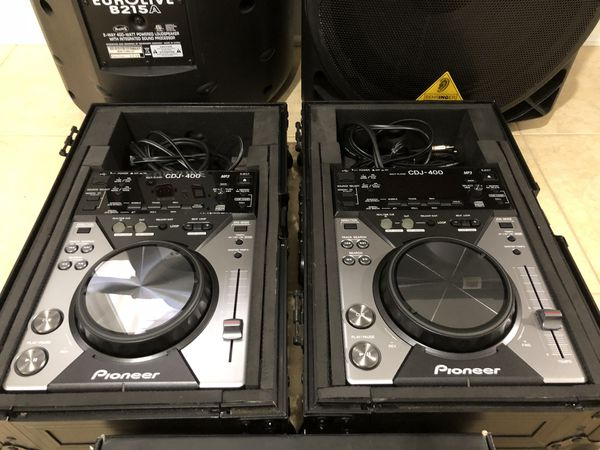 #2 Pioneer CDJ 400 players with black odyssey flight cases and Traktor Scratch Pro DJ software with Audio 10 sound card.