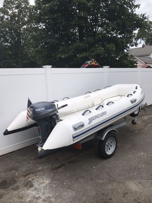 """Inflatable with Yamaha 15HP 2009 Mercury 330 11'2"""" ocean runner Hypalon fiberglass bottom.locking compartment foreword. for Sale in Wallingford, CT"""