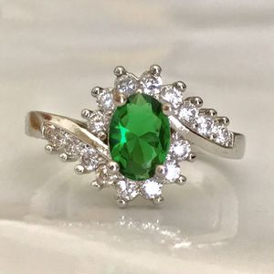 Sterling silver plated 925 stamped lab created diamonds surround lab emerald ring for Sale in Silver Spring, MD