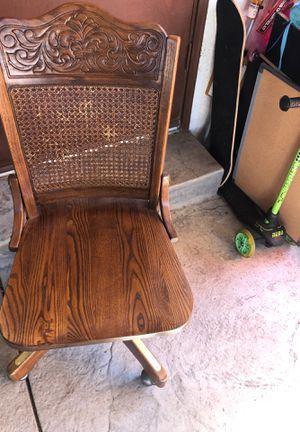Wooden swiveling desk chair on wheels for Sale in Fresno, CA