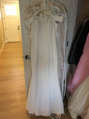 Size 10 wedding dress. Off white with off white shawl. No beads or sequins. Simple classic. No train. Worn once. Great condition. for Sale in Vancouver, WA