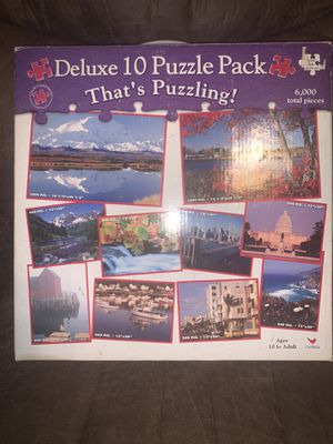 Vintage 10 puzzle set cardinal games that's puzzling. 8- 500 piece puzzles 2 - 1000 piece puzzles. for Sale in Wilton, CA