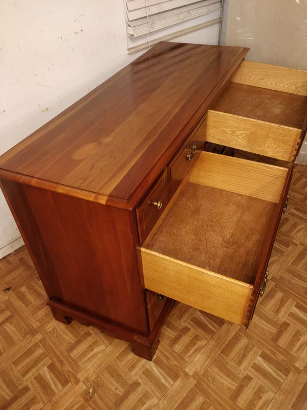 "Solid wood dresser with big drawers & mirror in good condition all drawers working well dovetail drawers driveway pickup. L52""*W19.2""*H33"""
