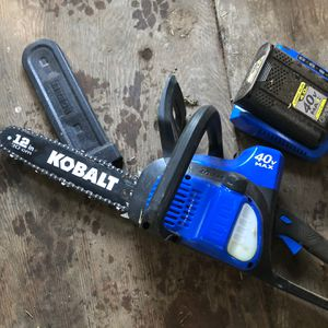 MOVING SALE!! Kobalt 12in 30cm Chain Saw w/ Battery Charger for Sale in Auburn, WA