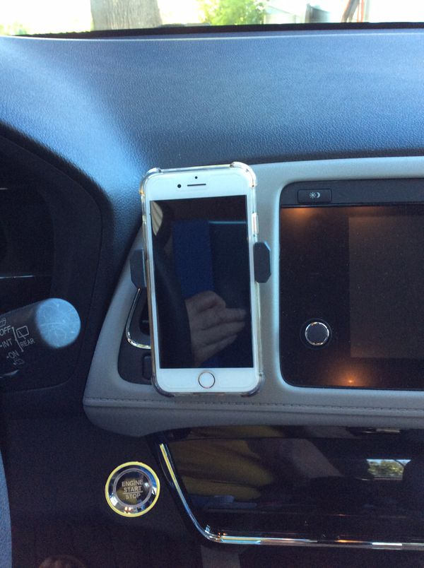 Phone holder .. clips onto car air vent