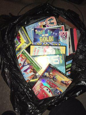 Trash bag filled with kids dvds for Sale in Worcester, MA
