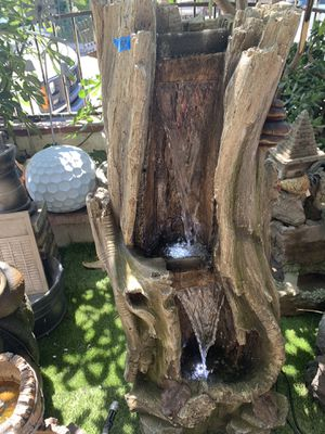 Big tree trunk fountain with lights for Sale in Bell, CA