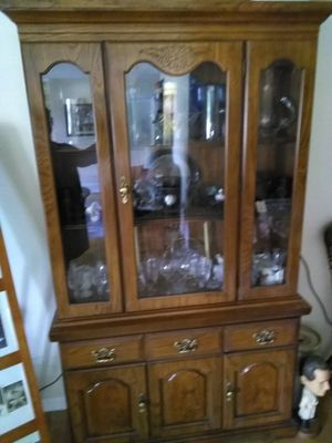 Hutch with center door; shelves for display. Storage underneath. Matching table posted separately. for Sale in St. Louis, MO