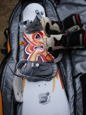 GNU Snowboard with boots never used also comes with bag for Sale in Louisville, KY