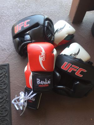 Two pair of boxing gloves and headgear S/M for Sale in Santa Ana, CA
