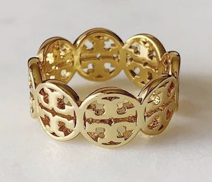 Tory Burch gold T LOGO FROZEN BAND RING for Sale in Macomb, MI