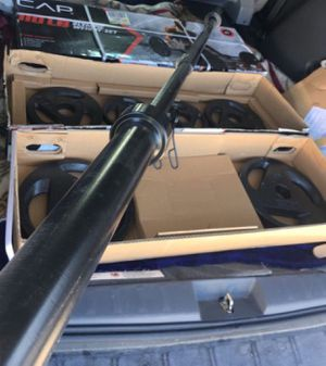 Weights Cap 110 lb Olympic weight set 30lb Olympic bar, 2x25lb,2x10lb and 2x5lb for Sale in Covina, CA