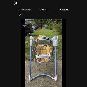 A baby swing for Sale in Dearborn, MI
