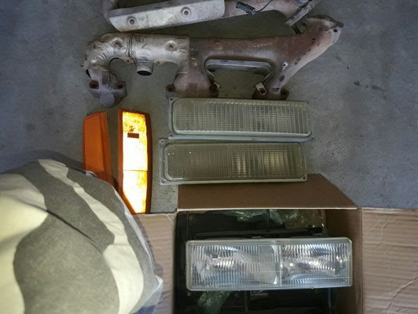 Have some chevy parts for sale such as headlights marker lights , throttle body and intake plus exhaust manifolds all in good condition