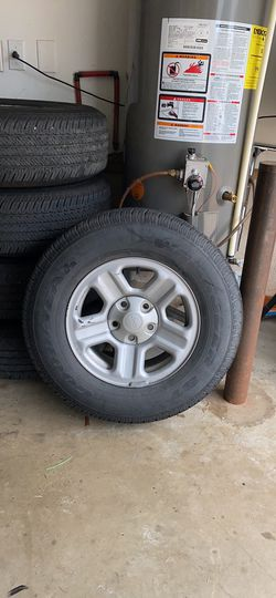 Stock jeep wheels and tires for Sale in Mooresville,  NC