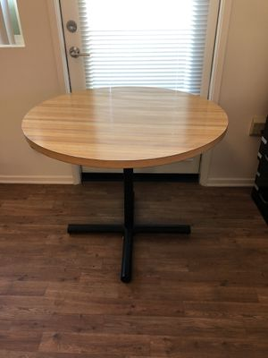 Round oak kitchen table with black iron legs for Sale in Menifee, CA