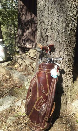 Left handed golf clubs spalding with brown leather h for Sale in Bronx, NY