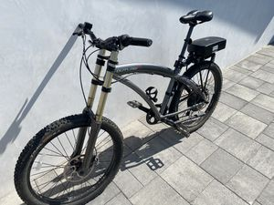 Mountain Bike electric Prodeco Outlaw EX. Long travel front suspension, Shimano XT disk brakes, tire pump, gel seat, kickstand. Electric mountain bike for Sale in Redondo Beach, CA