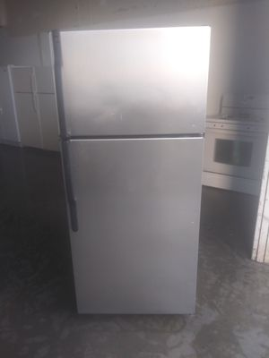 GE apartment size silver stainless steel style refrigerator for Sale in Lakewood, CA