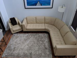 Natuzzi leather sectional couch & rotating chair for Sale in Tampa, FL