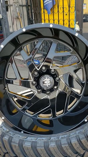 24x14 black hardcore rims 8 lug 8x170 on new mud terrain tires 35 1250 24 lt for Sale in Phoenix, AZ